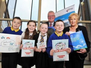 Councillors Jim Logue and Helen McKenna with pupils from St Timothy