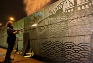 Graffiti artist Moose creates a mural of London with a Nissan-powered jet wash