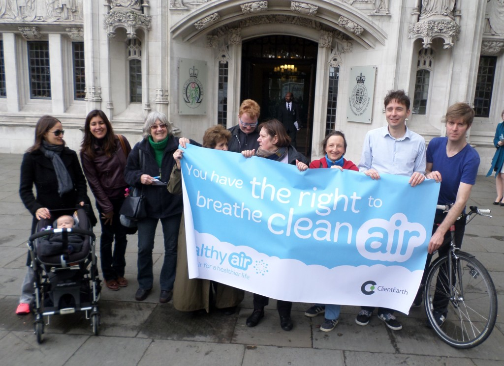 Members of ClientEarth and the Healthy Air campaign celebrate today's Judgement outside the Supreme Court
