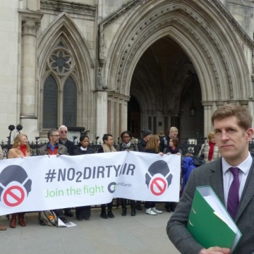 ClientEarth lawyer Alan Andrews with supporters outside the Royal Courts of Justice after lodging the court papers in March