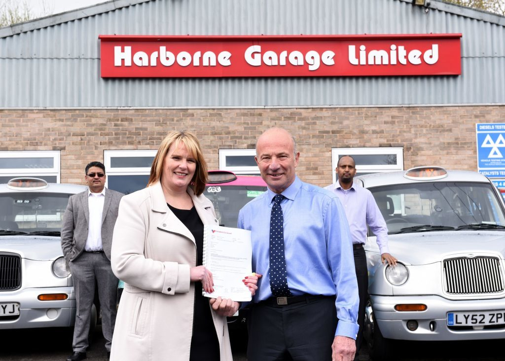 Harborne Garage where the conversion to LPG takes place, pictured are: Anne Shaw, assistant director for transportation at Birmingham city council, with Steve White of Harborne Garage