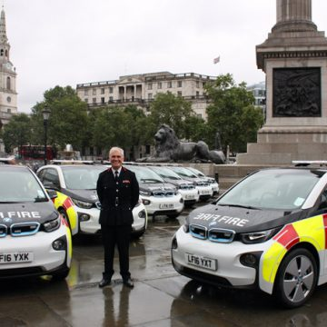 London Fire Commissioner Ron Dobson with some of the low emission vehicle fleet