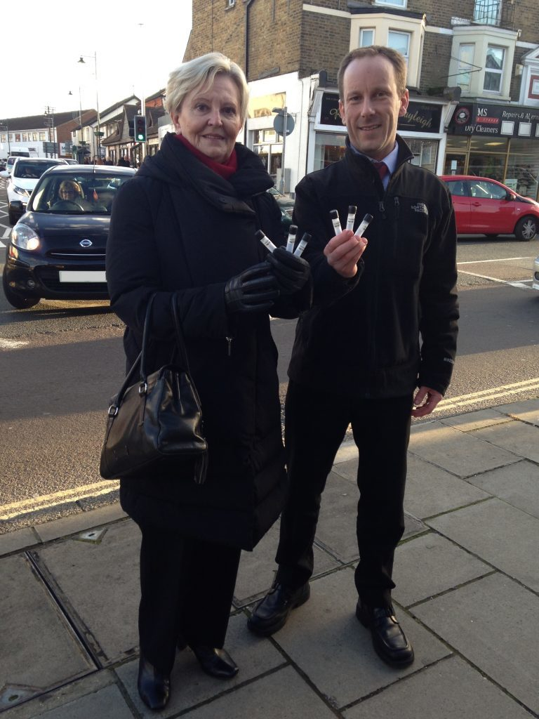 Cllr June Lumley and Rochford council's Environmental Health Team Leader, Martin Howlett in Rayleigh Town Centre holding diffusion tubes.