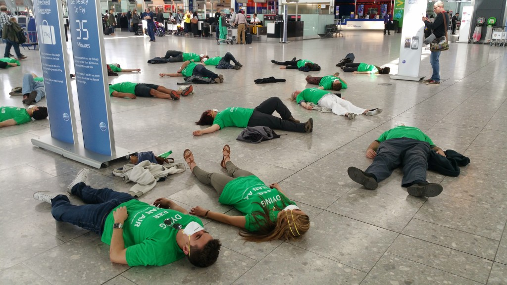 Air Pollution Protestors Stage Lie In At Heathrow Air