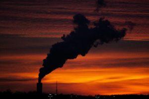 silhouette of factory smoke