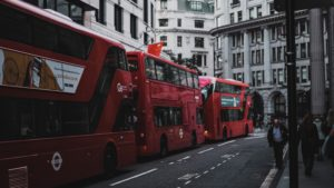 three red double decker buses