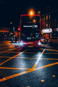 red and black double decker bus on road during night time