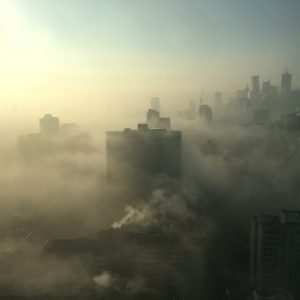 city with high-rise building covered with fogs